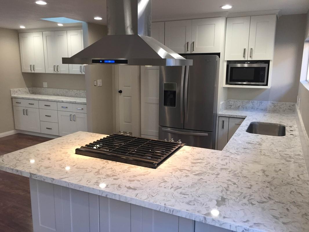 Kitchen white shaker cabinets quartz countertop in los for Prefab cupboards