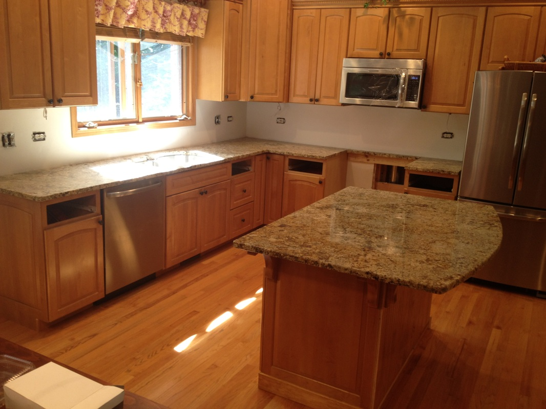 Granite slab work kitchen prefab cabinets rta kitchen for Kitchen designs namibia