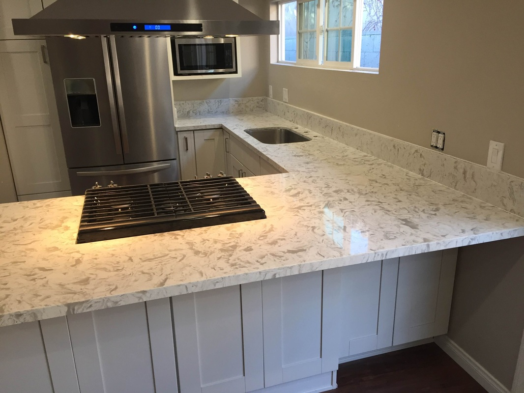 Quartz countertops for white cabinets home decor for Who makes quartz countertops
