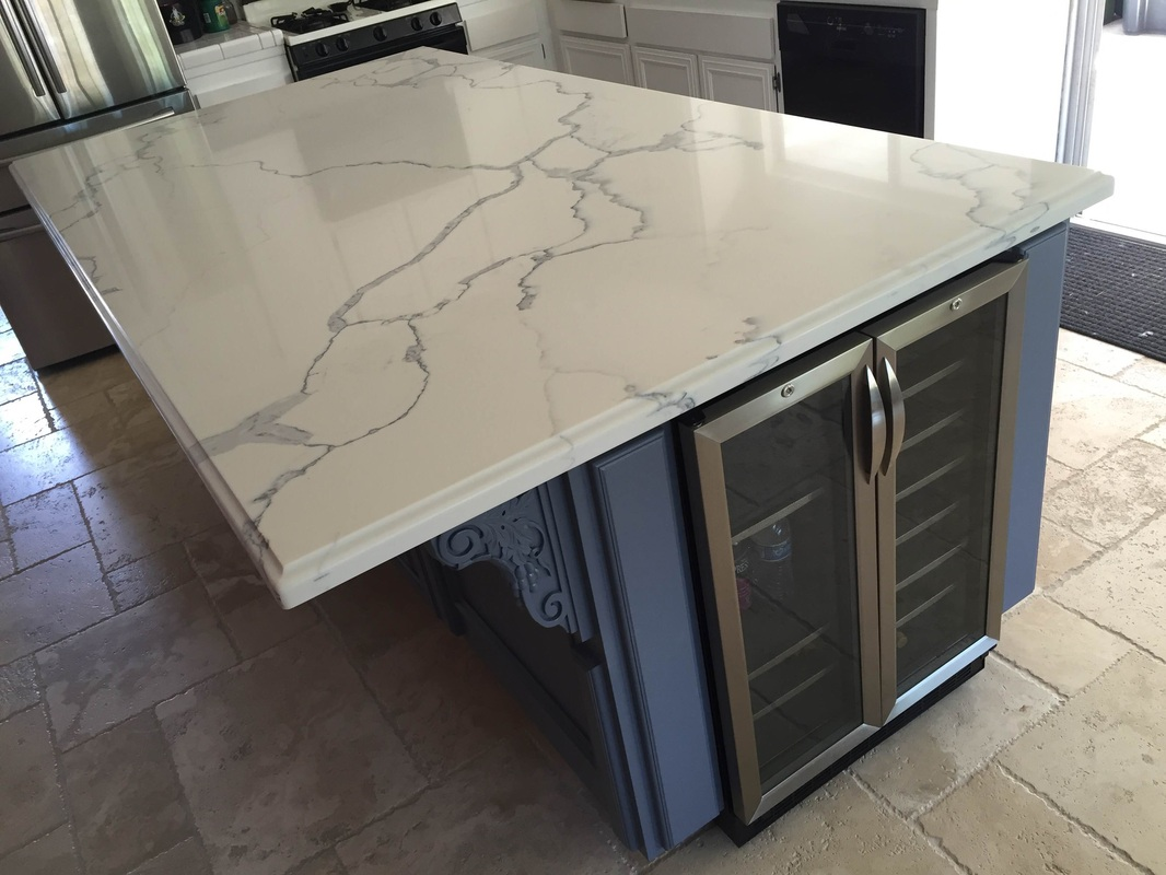 QUARTZ 4 X 8 ISLAND WITH OGEE SQUARE EDGE NATHANSIMI