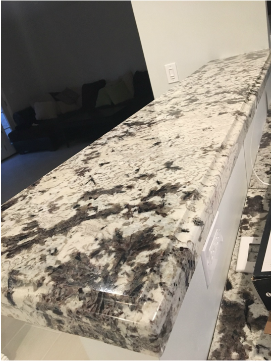 Frameless Espresso Raised Panel Kitchen Cabinets With Ogee Square Edge Granite Countertop For