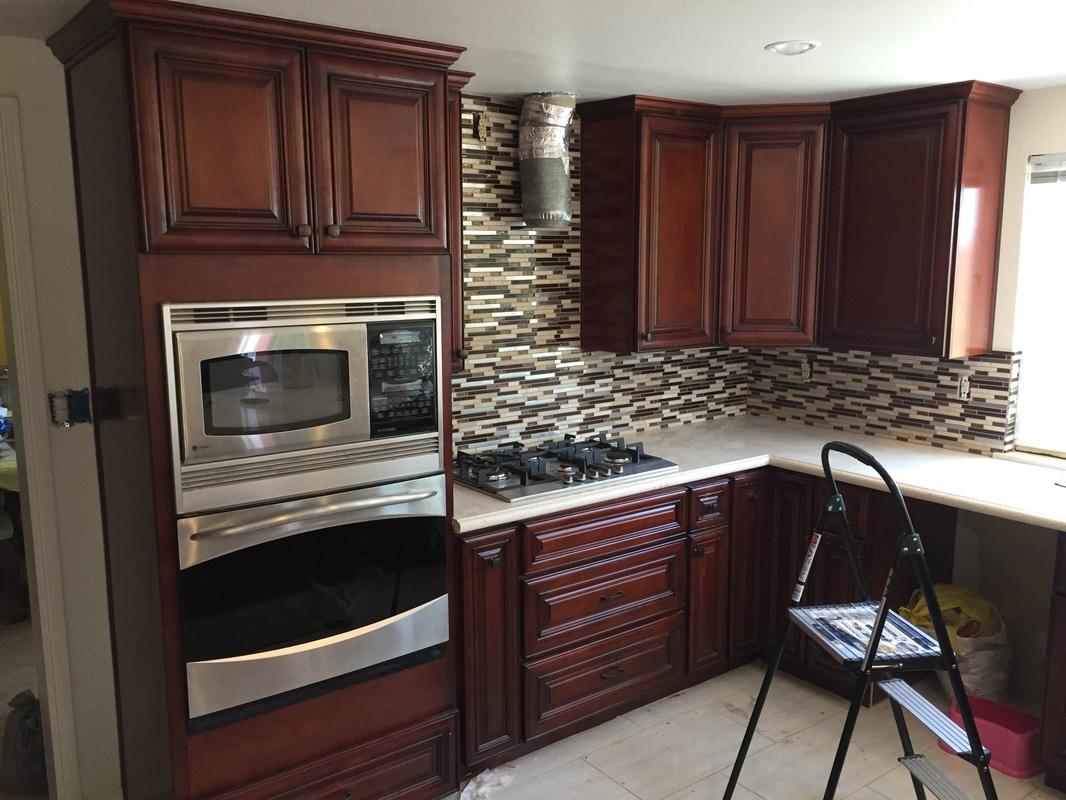 Dark Cherry Glaze Kitchen Cabinets With Quartz Countertop