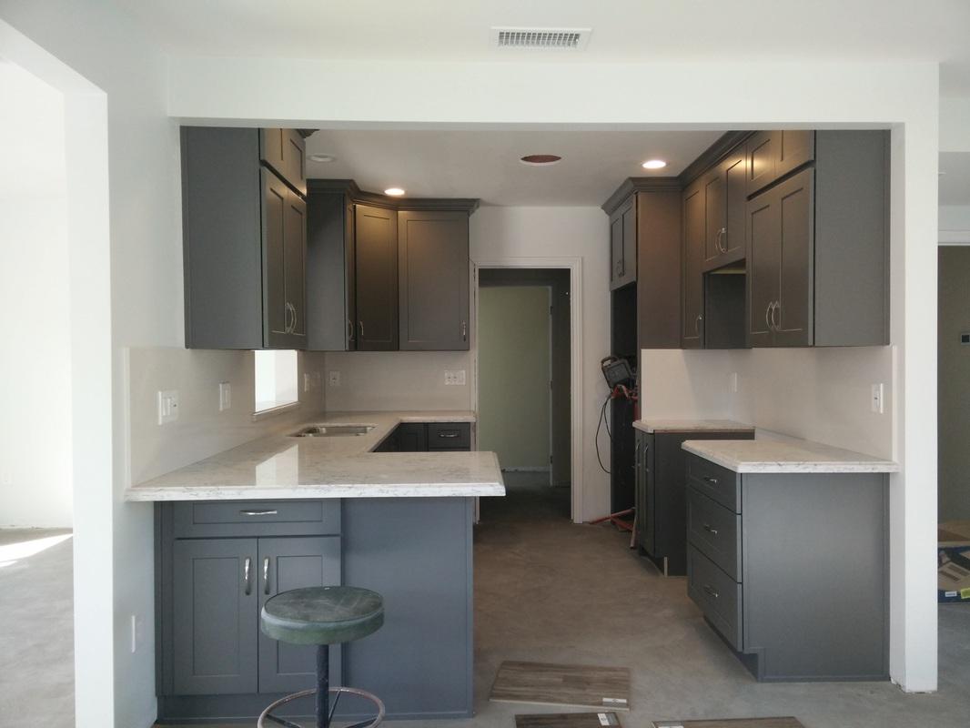 Dark Gray Shaker Cabinets With Silestone Quartz Countertop