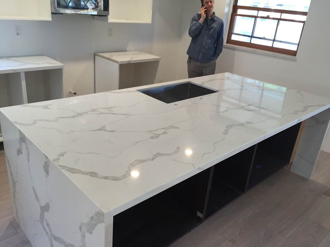 Calacatta Gold Quartz Countertop Mitered Edeg And Island With Waterfall For Giuli Haro Downey Ca Kitchen Prefab Cabinets Rta