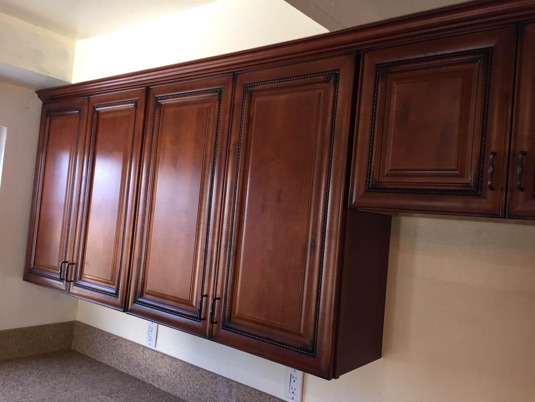 merlot cherry rope kitchen cabinets with quartz mitered ...